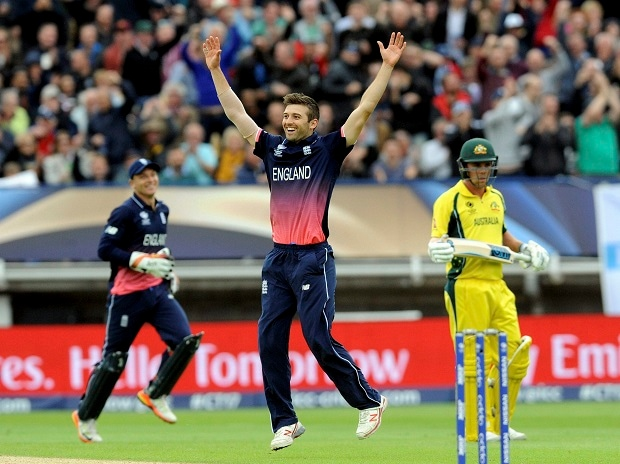 England's Mark Wood celebrates after bowling Australia's Glenn Maxwell caught by England's Jason Roy for 20 runs during an ICC Champions Trophy match between England and Australia at Edgbaston. Photo: PTI