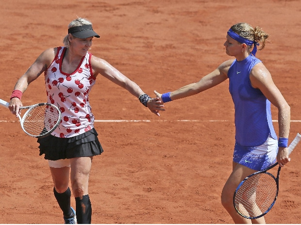 Bethanie Mattek-Sands of the U.S., left, and Lucie Safarova of the Czech Republic celebrate scoring a point against Ashleigh Barty and Casey Dellacqua of Australia during the women's doubles final match of the French Open. Photo: AP/PTI