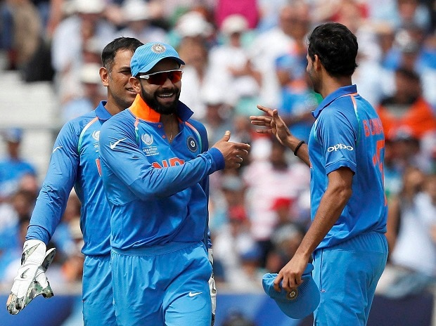 Virat Kohli, left, celebrates with Bhuvneshwar Kumar, right, after they bowl out South Africa for 191 during the ICC Champions Trophy match between India and South Africa at The Oval cricket ground in London. Photo: PTI