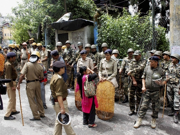 Security personnel ask for the identity of a woman during a strike called by Gorkha Janmukti Morcha in Darjeeling Hills