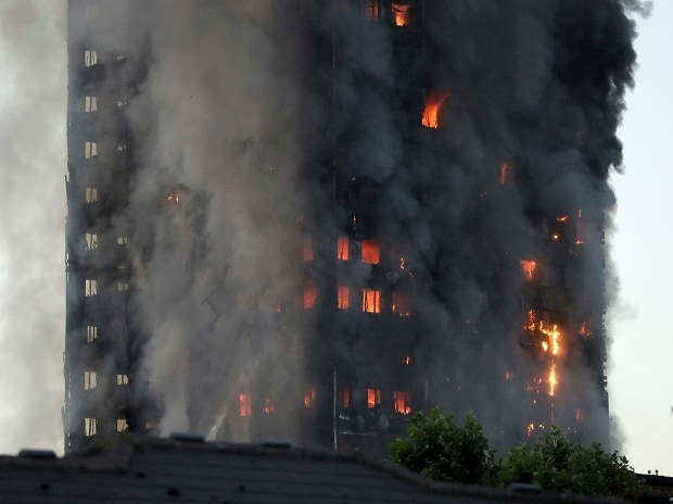 Flames rise from building on fire in London, Wednesday, June 14, 2017. Metropolitan Police in London say they're continuing to evacuate people from a massive apartment fire in west London. Photo: AP/PTI