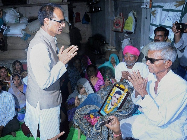 Madhya Pradesh Chief Minister Shivraj Singh Chouhan meeting the farmer's  family, killed in police firing. Photo: PTI