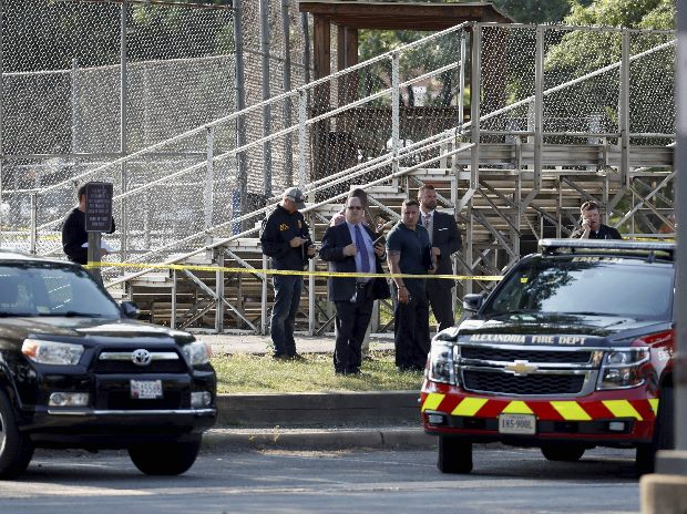 Law enforcement officers investigate the scene of a shooting near a baseball field in Alexandria (Photo: AP/PTI)
