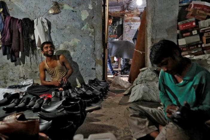 Shoe-makers work in an underground workshop in Agra, India, June 9, 2017. Picture taken June 9, 2017. REUTERS/Cathal McNaughton