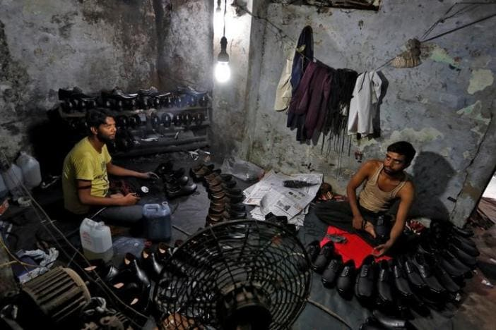 Shoe-makers work in an underground workshop in Agra, India, June 9, 2017. Picture taken June 9, 2017. REUTERS