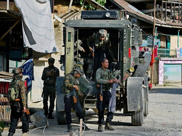 Army jawans stand guard during an encounter with militants at Arwani village of Anantnag district of South Kashmir on Friday. Two youth were killed and nearly a dozen others injured as security forces opened firing to chase away stone-pelting protest