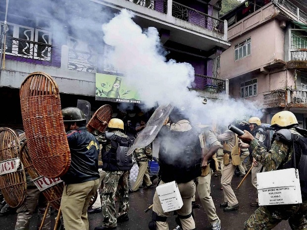 Security personnel fire tear gas during a protest by Gorkha Janmukti Morcha (GJM) activists in Darjeeling, West Bengal.