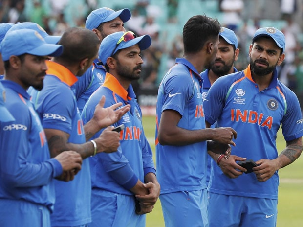 'I have a smile on my face because we played well to reach the final,' Virat Kohli said