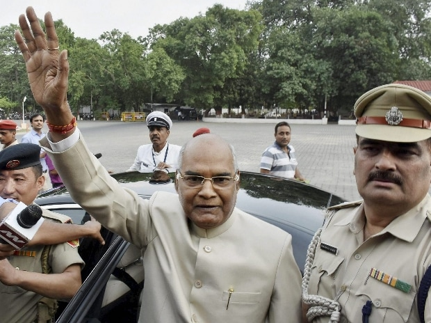 Bihar Governor Ram Nath Kovind, NDA's presidential candidate, waves at the media as he leaves for Delhi at Raj Bhavan in Patna.