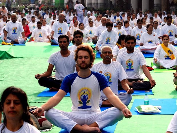 See pics: Hope you practice 'asanas' everyday, says Kejriwal on Yoga Day