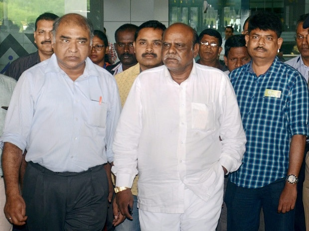 Former Calcutta HC judge C S Karnan upon his arrival at the airport in Kolkata . Karnan, who was arrested from Coimbatore on Tuesday, more than a month after the Supreme Court sentenced him for contempt of court, was brought to Ko