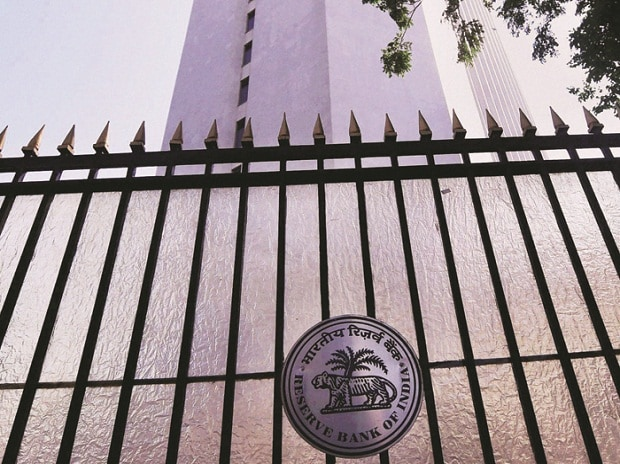 RBI lowers growth projection, bank stocks surge as SLR drops