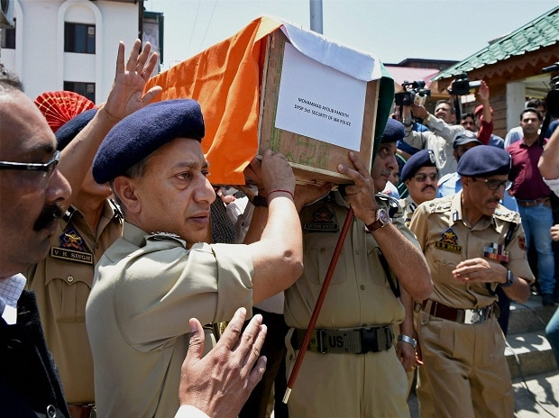 Srinagar: Director General of Jammu and Kashmir Police S P Vaid and other senior officers carrying the coffin of DSP Mohammad Ayub Pandith during a wreath laying ceremony at District Police Lines in Srinagar on Friday. (Photo: PTI)
