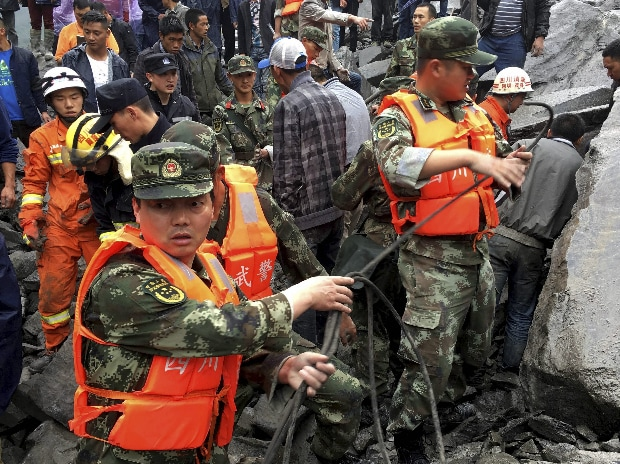 Xinmo: Dozens of people are feared buried by a landslide that unleashed huge rocks and a mass of earth that crashed into their homes in southwestern China early Saturday. (Photo: PTI)