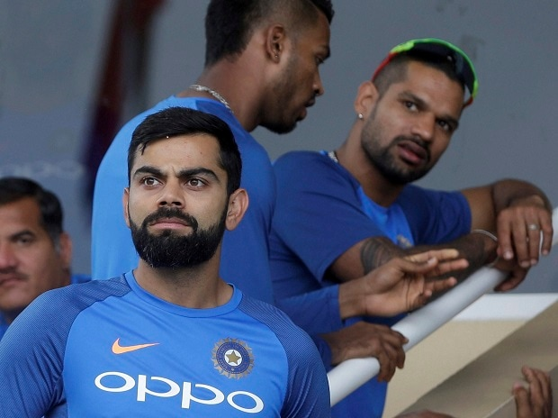 India's captain Virat Kohli looks at the field from the pavilion as the start of the second ODI cricket match against West Indies is delayed due to rain at Queen's Park Oval in Port of Spain, Trinidad and Tobago, Sunday, June 25. Photo: AP/PTI
