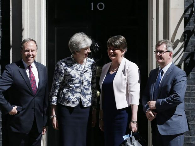 UK PM May strikes 1 bn pound deal to get N.Irish DUP support for her govt