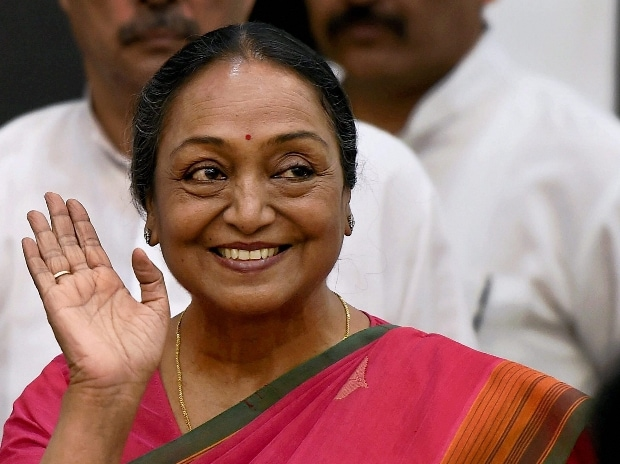 Presidential Candidate Meira Kumar greets the media as she arrives for the press conference in New Delhi