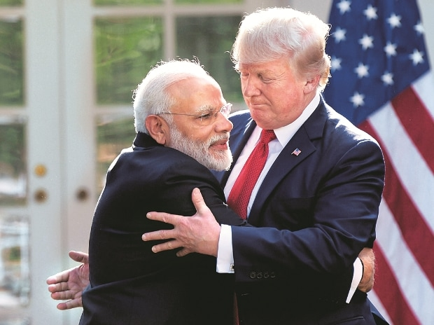 US President Donald Trump and Prime Minister Narendra Modi (left) hug at the Rose Garden of the White House in Washington