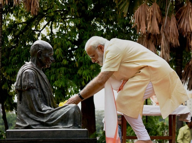 Ahmedabad: Prime Minister Narendra Modi offers flowers to  a statue of Mahatma Gandhi at the Sabarmati Ashram in Ahmedabad on Thursday.