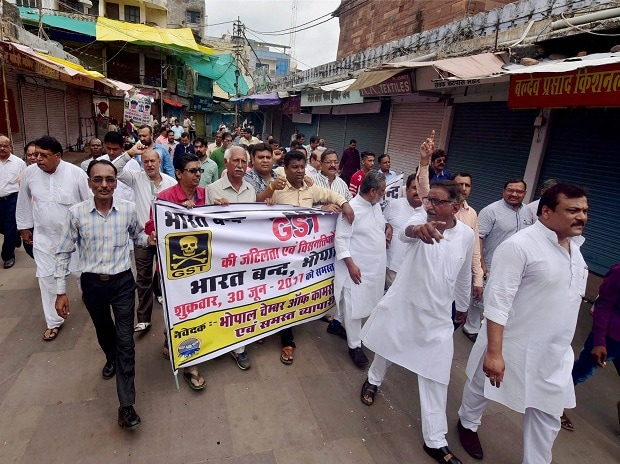 Shopkeepers and traders take out a rally during a bandh called by Chamber of Commerce & Industries, in protest against GST, in Bhopal. Photo: PTI