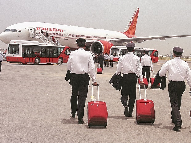 Air India employees walk towards flight
