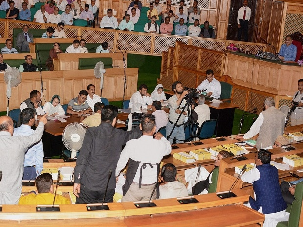 Opposition National Conference and Congress MLA's shout slogans during their protest against the implementation of Goods and Services Tax (GST) during the Special Session of Legislative Assembly, which was called to pass the GST bill, in Srinagar