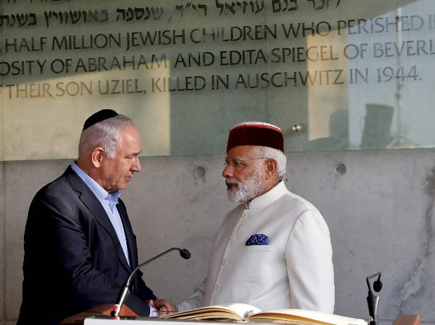 Jerusalem : Indian Prime Minister Narendra Damodardas Modi, right, shakes hands with Israeli Prime Minister Benjamin Netanyahu after signing the guestbook at the Yad Vashem Holocaust memorial museum in Jerusalem, Tuesday, July 4 2017. Photo: PTI