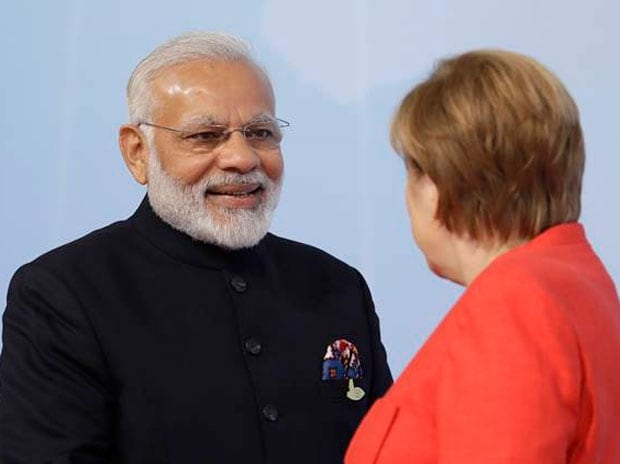 PM Modi, left, is welcomed by German Chancellor Angela Merkel on the first day of the G-20 summit in Hamburg, northern Germany, Friday, July 7, 2017. (Twitter)