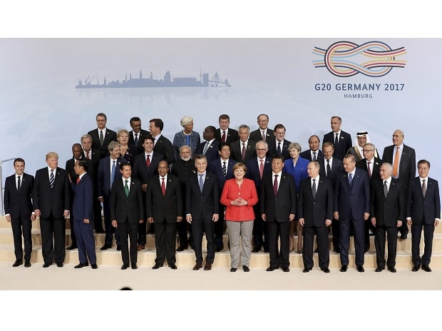 The participants pose for a group photo on the first day of the G-20 summit in Hamburg