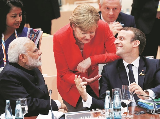 French President Emmanuel Macron with German Chancellor Angela Merkel and Prime Minister Narendra Modi during the G20 leaders summit in Hamburg