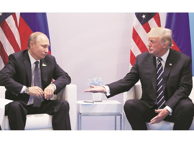 US President Donald Trump (right) offered no details about what issues he and the Russian President Vladimir Putin had discussed, describing them only as 'various things'. Photo: Reuters