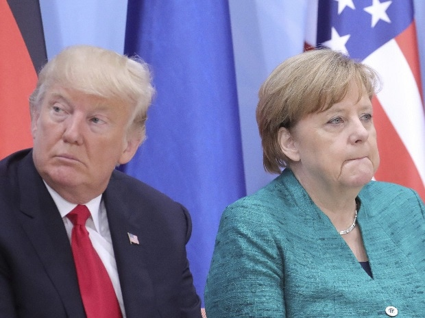 US President Donald Trump and  German Chancellor Angela Merkel attend a panel session at the G20 summit in Hamburg, Germany, on July 8, 2017. (Photo: AP/PTI)