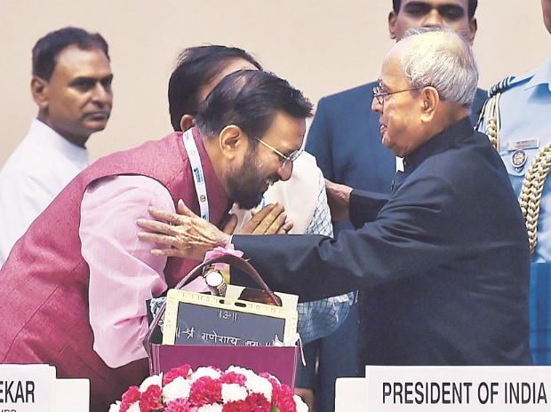 Minister of Human Resource Development Prakash Javadekar (right) with  President Pranab Mukherjee during the National Convention on Digital Initiatives for Higher Education in New Delhi on Sunday (Photo: PTI)