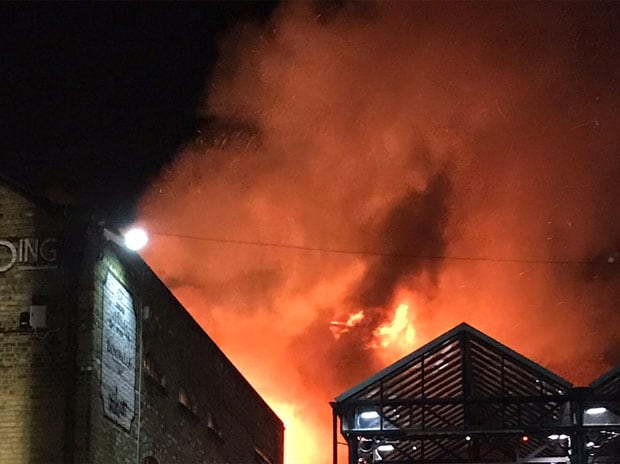 We now have ten fire engines and over 70 firefighters dealing with the Camden Lock Market fire. Please avoid the area: London Fire Brigade