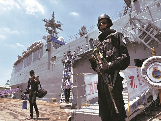An Indian Navy commando maintains vigil near the INS Shivalik in Chennai on Monday. The frigate is part of the India, Japan and US joint naval exercise. Photo: PTI