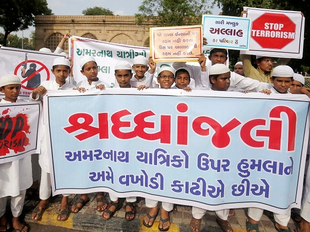 Muslims participate in a protest against the terror attack on Amarnath piligrims, in Ahmedabad