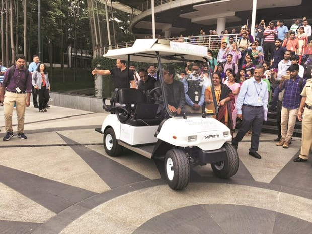 Taking forward his love for automation, Infosys CEO Vishal Sikka (in the front seat) arrived at the company's Bengaluru headquarters in a driverless golf cart, built by the firm's engineers, on Friday. Photo: Vishal sikka's official Twitter handle