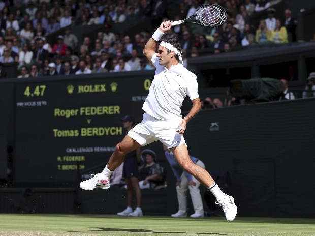 Switzerland's Roger Federer returns to Czech Republic's Tomas Berdych during their Men's Singles semifinal match on day eleven at the Wimbledon Tennis Championships in London.
