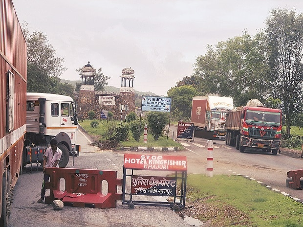 Trucks held up at a check-point in Rajasthan. While the time taken by trucks to travel between states has gone down, the benefits of the GST have not been uniform. Photo:  N Sundaresha Subramanian