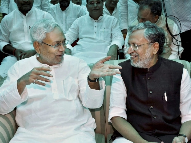 Bihar CM Nitish Kumar with Deputy CM Sushil Modi at an oath taking ceremony at Raj Bhawan in Patna.