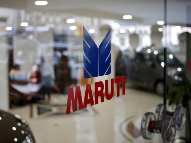 The logo of Maruti Suzuki India Limited is seen on a glass door at a showroom in New Delhi, India. (Photo: Reuters)