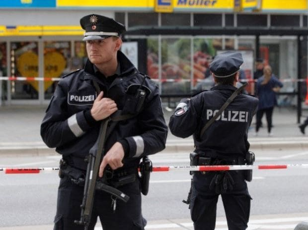 Police guard the attack site in Hamburg, Germany