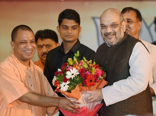 Image result for yogi adityanath with roses