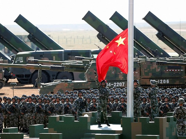 Chinese People's Liberation Army (PLA) troops perform a flag raising ceremony on July 30 for a military parade to commemorate the 90th anniversary of the founding of the PLA on Aug 1 at Zhurihe training base. (Photo: PTI)