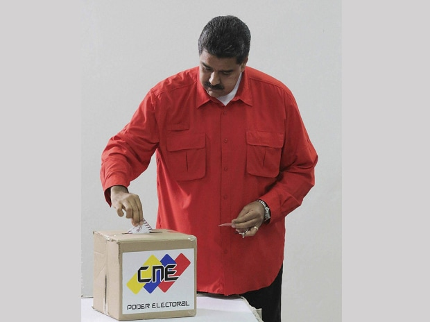Venezuela's President Nicolas Maduro casts his ballot as he votes for a constitutional assembly in Caracas, Venezuela. (Photo: AP/PTI)