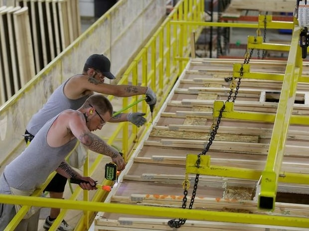 Workers build the roof of a single axel towable Pioneer traditional recreational vehicle at the Thor Industries Heartland RV Assembly Plant in Elkhart, Indiana. (Photo: Reuters)