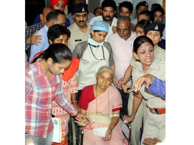 Social activist Medha Patkar discharge from  hospital in Indore on Wednesday. Photo: PTI