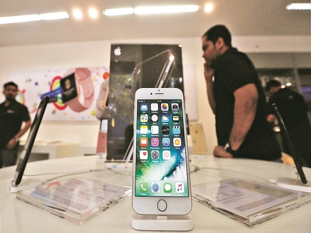 An iPhone is seen on display at a kiosk at an Apple reseller store in Mumbai. Trai, which has been exchanging e-mails with Apple Inc for over a year to find a solution to the impasse, is still open to discussions on the Do Not Disturb (DND) app issue