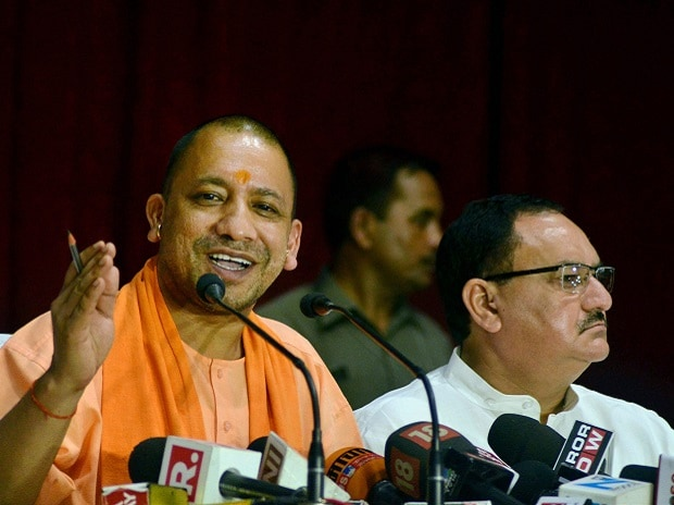 Uttar Pradesh Chief Minister Yogi Adityanath and Union Health Minister J P Nadda during a press conference after visiting BRD Medical College in Gorakhpur. Photo: PTI