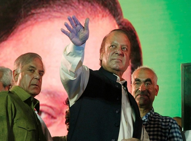 Lahore : Deposed Pakistani Prime Minister Nawaz Sharif waves to his supporters upon arrival to address a rally in Lahore, Pakistan, Saturday, Aug. 12, 2017. A massive crowd of supporters has greeted Sharif in his hometown of Lahore at a large rally t